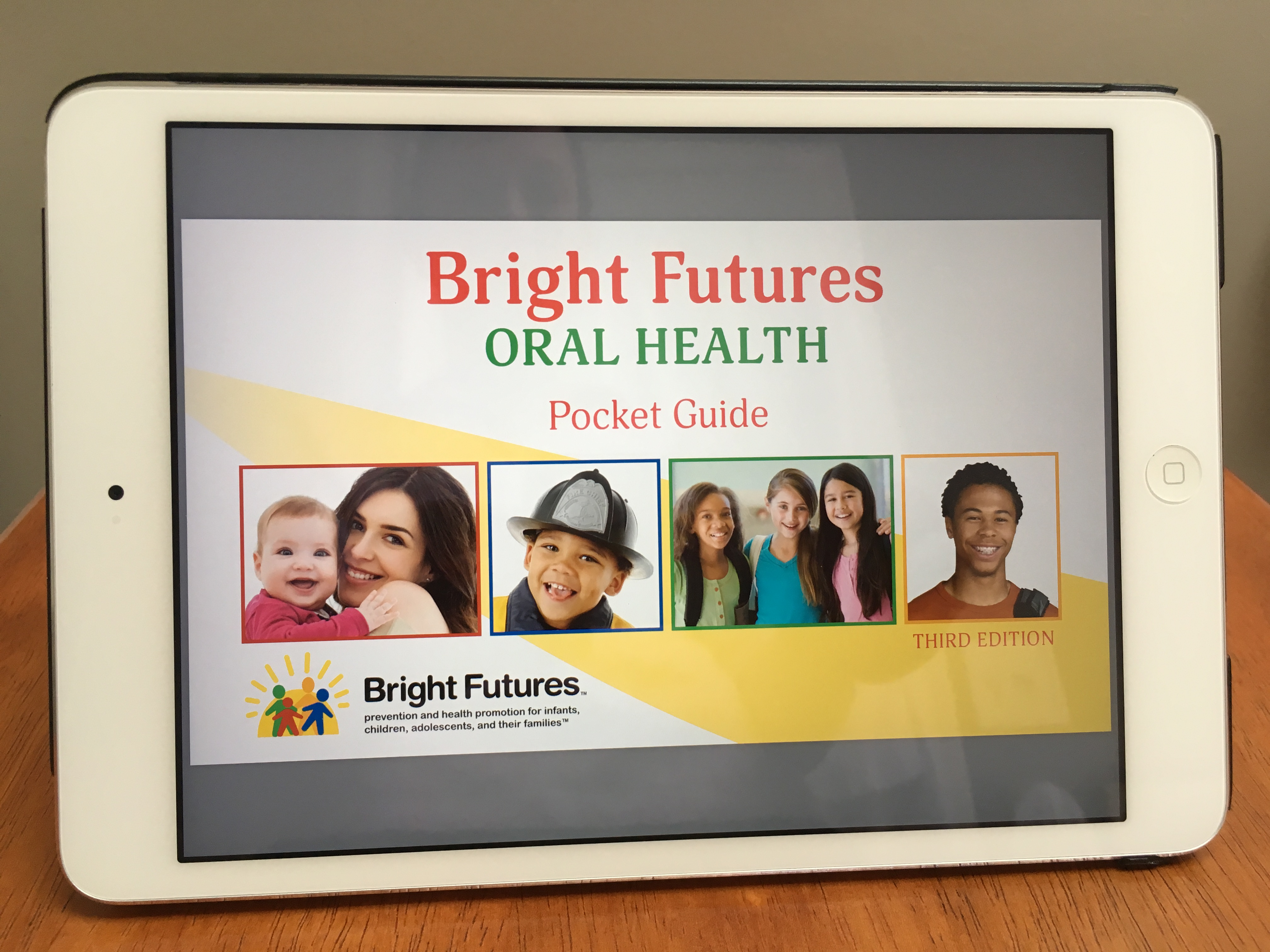 image of Bright Futures Oral Health Pocket Guide on a mobile device